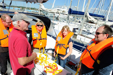 Senior-Sailing-Instructor-Giving-Safety-Briefing